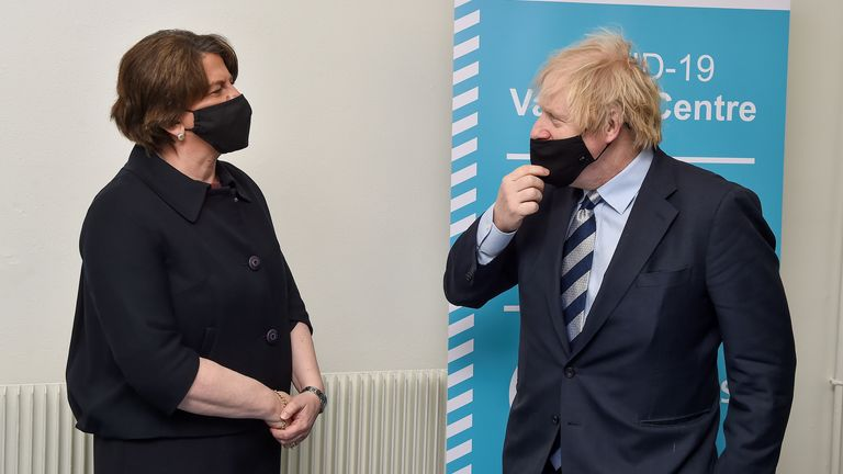 ritish Prime Minister Boris Johnson is greeted by Northern Ireland's First Minister Arlene Foster