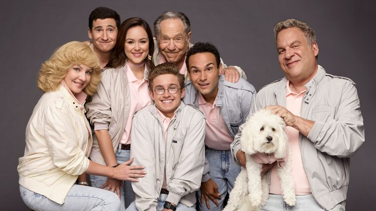 "ABC's ""The Goldbergs"" stars Wendi McLendon-Covey as Beverly Goldberg, Sam Lerner as Geoff Schwartz, Hayley Orrantia as Erica Goldberg, Sean Giambrone as Adam Goldberg, George Segal as Pops Solomon, Troy Gentile as Barry Goldberg, Sage as Lucky Goldberg, and Jeff Garlin as Murray Goldberg. (ABC/Andrew Eccles)"