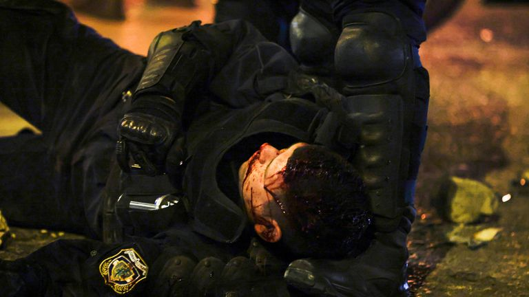 Officer seriously hurt as Athens protests over claims of police brutality turn violent