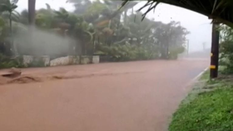 Hawaii road is flooded after local dam breaks