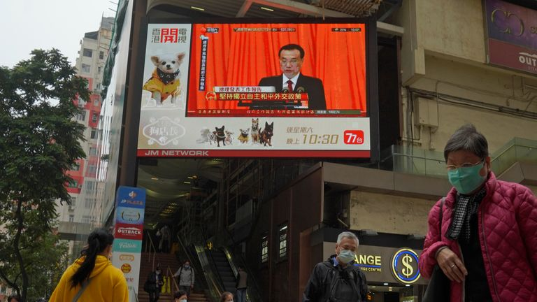 The National People's Congress is broadcast to the streets of Hong Kong. Pic: AP