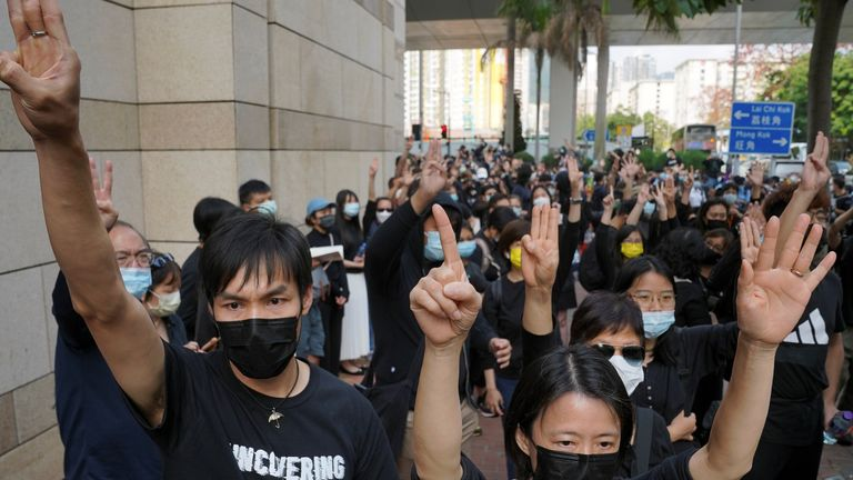 Protesters outside a Hong Kong court where pro-democracy activists face charges related to national security