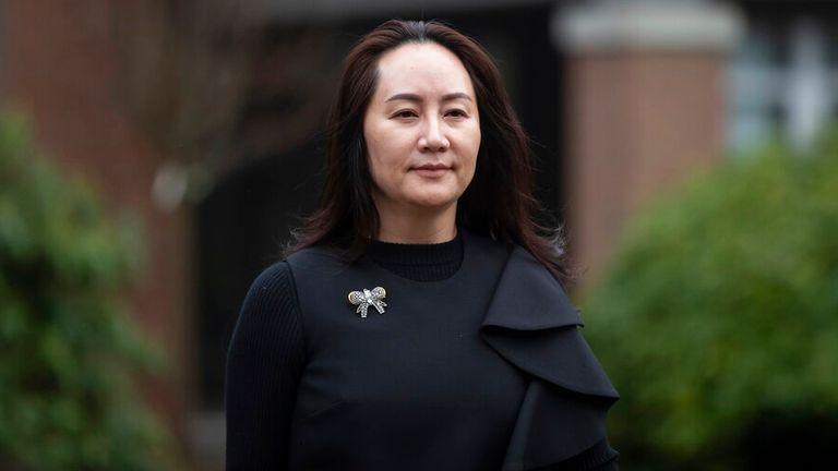 Meng Wanzhou, chief financial officer of Huawei, leaves her home to attend a hearing at B.C. Supreme Court, in Vancouver, B.C., Wednesday, Dec. 9, 2020. (Darryl Dyck/The Canadian Press via AP)