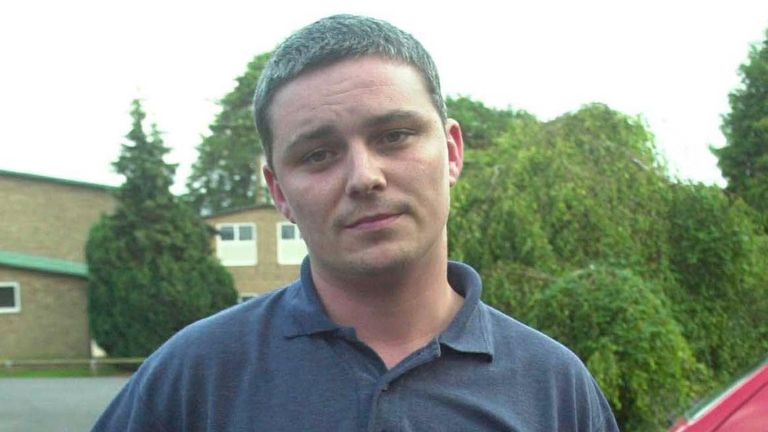 UNDATED FILE PHOTO - School caretaker Ian Huntley poses for a picture outside his home in Soham, Cambridgeshire in this undated file photo. [Huntley has been taken to the police station on August 16, 2002, voluntarily to help police with their enquiries after the disappearance of the ten year old school girls Holly Wells and Jessica Chapman on August 4, 2002.]