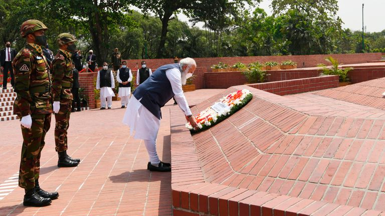 Indian Prime Minister Narendra Modi lays flowers at the National Martyrs' Memorial in Dhaka