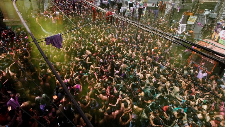 Indian revelers dance during celebrations to mark Holi, the Hindu festival of colors