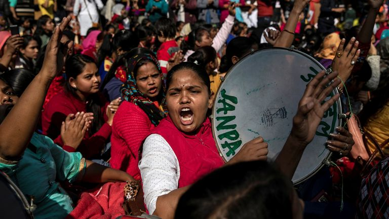 Demonstrators shout slogans as they take part in a protest against the alleged rape and murder of a 27-year-old woman on the outskirts of Hyderabad, in New Delhi