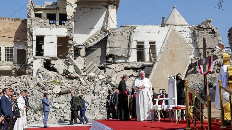 Pope Francis, surrounded by shells of destroyed churches, arrives to pray at Hosh al-Bieaa Church Square, in Mosul. Pic: AP