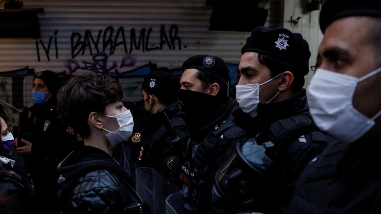 A protester stood facing a line of police at the demonstration in Istanbul
