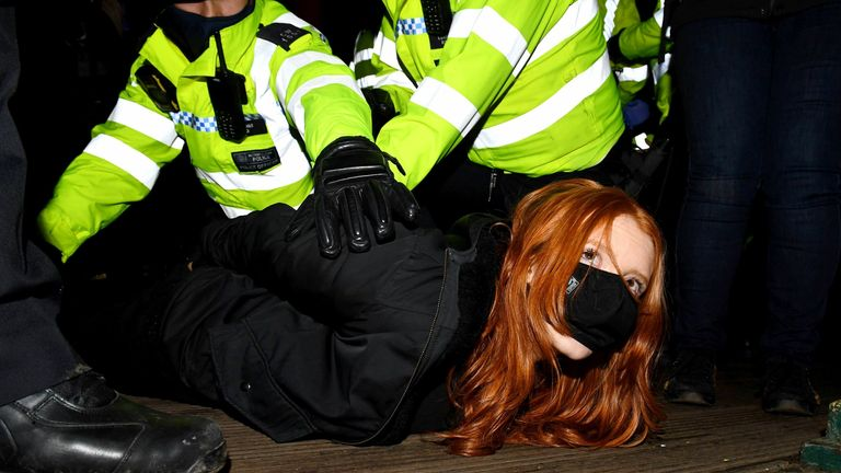 A woman is arrested at a vigil in memory of Sarah Everard. Pic: James Veysey/Shutterstock