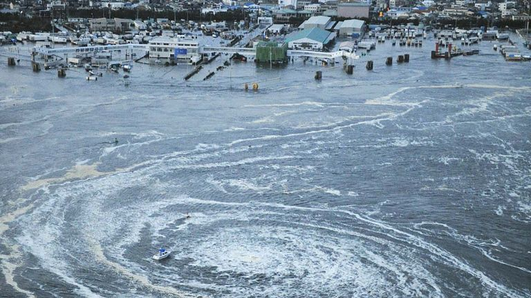 TOKYO, Japan - Photo taken from a Kyodo News helicopter shows a whirlpool caused by a tsunami near a port in Oarai, Ibaraki Prefecture, after a powerful earthquake hit northeastern Japan on March 11, 2011. (Kyodo via AP Images)