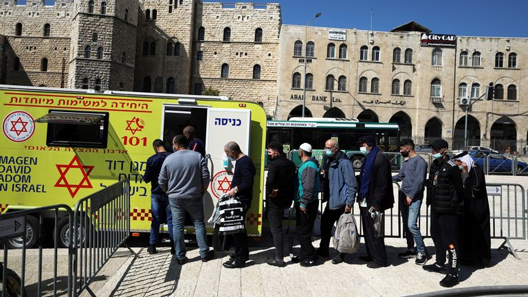 People queuing at a mobile vaccination centre in Jerusalem