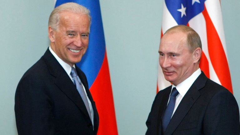 FILE - In this March 10, 2011, file photo, then-Vice President Joe Biden, left, shakes hands with Russian Prime Minister Vladimir Putin in Moscow, Russia. Russia and the United States exchanged documents Tuesday Jan. 26, 2021, to extend the New START nuclear treaty, their last remaining arms control pact, the Kremlin said. The Kremlin readout of a phone call between U.S. President Joe Biden and Russian President Vladimir Putin said they voiced satisfaction with the move. (AP Photo/Alexander Zeml