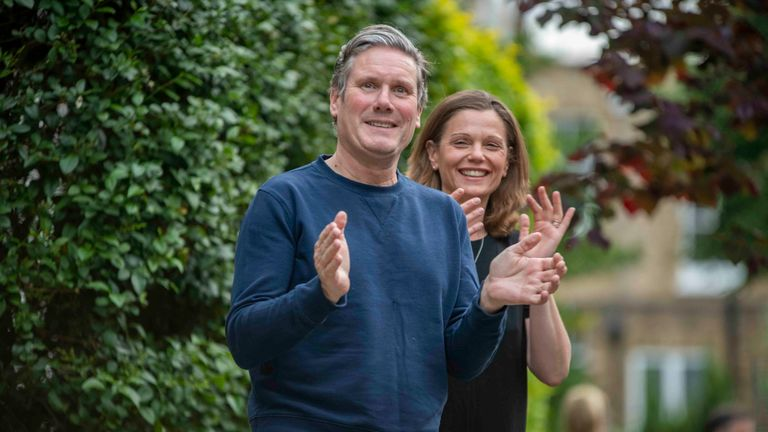 Sir Keir Starmer and his wife Victoria clapping for the NHS
