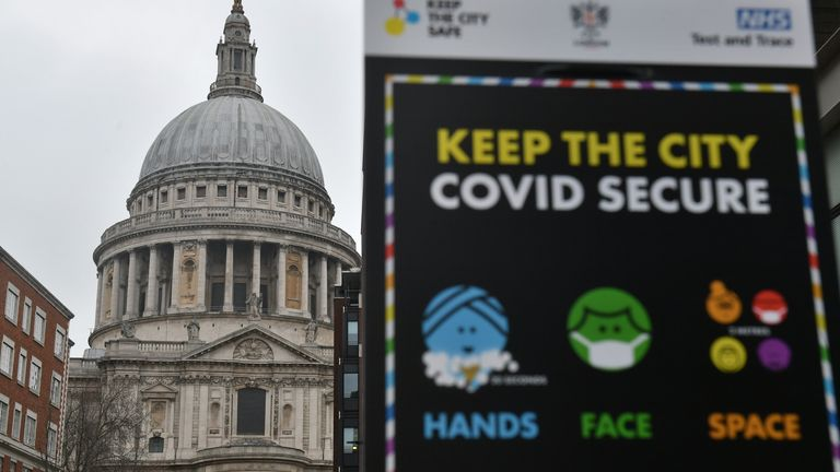 """Covid-19 signage in front of St Paul's Cathedral, after Mayor of London Sadiq Khan declared a """"major incident"""" as the spread of coronavirus threatens to """"overwhelm"""" the capital's hospitals"""