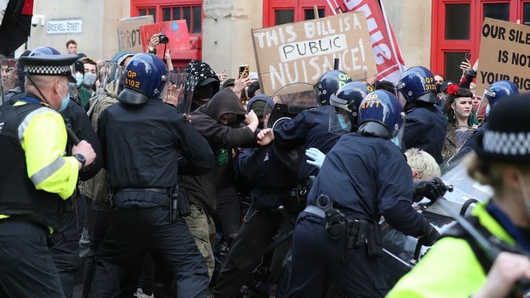 Police hold back people outside Bridewell Police Station as they take part in a 'Kill the Bill' protest in Bristol, demonstrating against the Government's controversial Police and Crime Bill. Picture date: Sunday March 21, 2021.