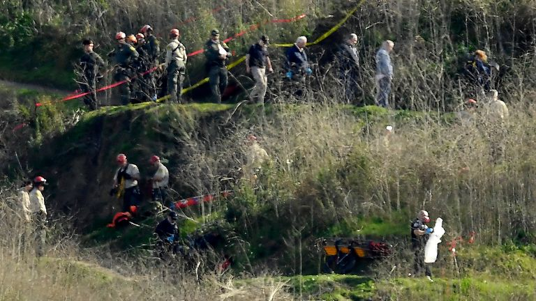 Investigators working the scene of a helicopter crash that killed Kobe Bryant in January 2020 in Calabasas, California. Pic: AP