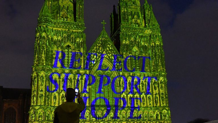 Lichfield Cathedral lit in yellow