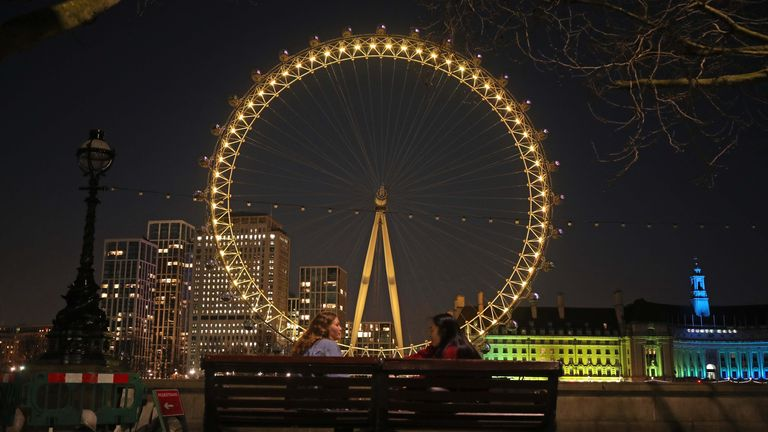 The London Eye lit in yellow for national day of reflection