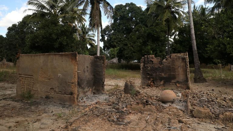 Burnt-out huts are seen at the scene of an armed attack in Chitolo village, Mozambique