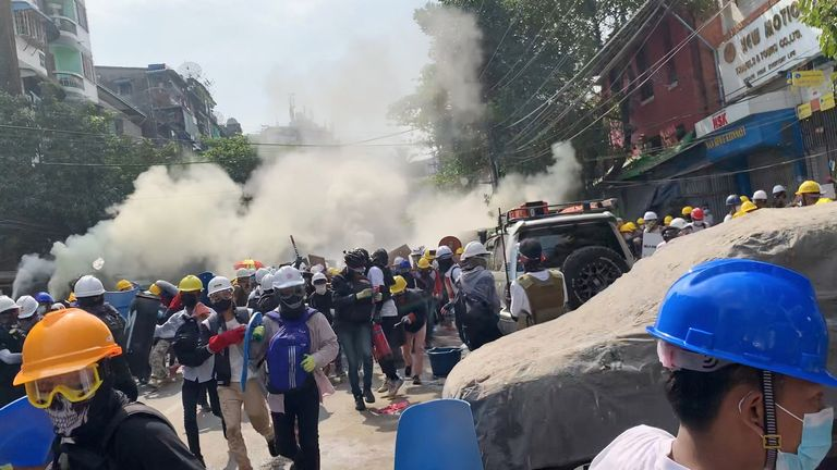 Protesters used smoke grenades to block the view from snipers in Sanchaung, Yangon