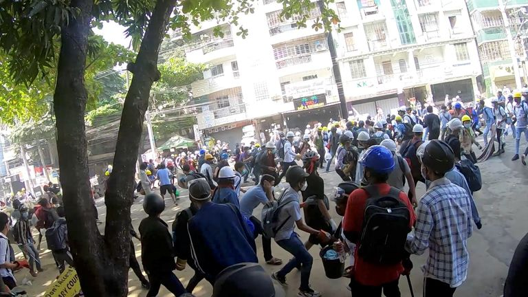 Police used stun grenades and fired shots to try to disperse protesters