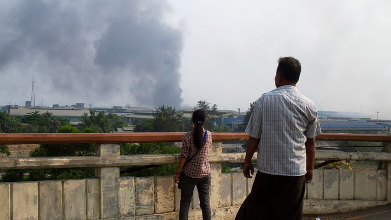 Plumes of smoke are seen after clothes factories in Myanmar were set on fire