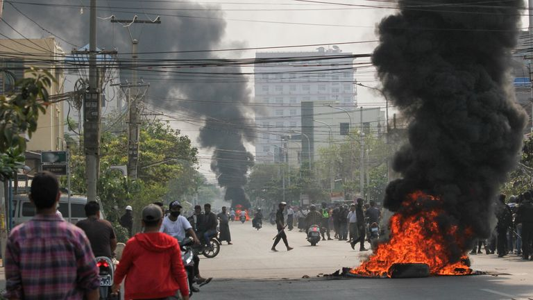 Tires burn on a street as protests against the military coup continue, in Mandalay, Myanmar March 27, 2021. REUTERS/Stringer