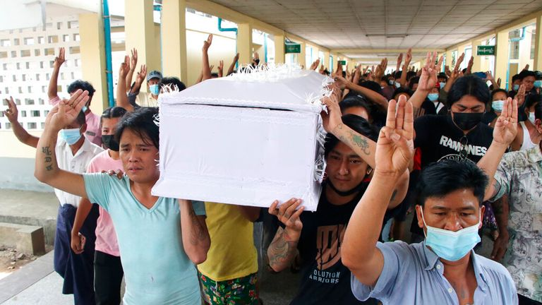People carry the coffin of a man who was killed during a clash with Myanmar's security forces