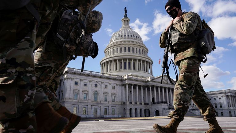 Members of the National Guard walk past the U.S. Capitol after the Senate passed U.S. President Joe Biden's $1.9 trillion COVID-19 relief plan in a party-line vote in Washington, U.S., March 6, 2021. REUTERS/Joshua Roberts