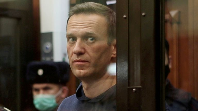 Alexei Navalny inside a defendant dock during the announcement of a court verdict in Moscow, Russia February 2, 2021. Pic: Press service of Simonovsky District Court