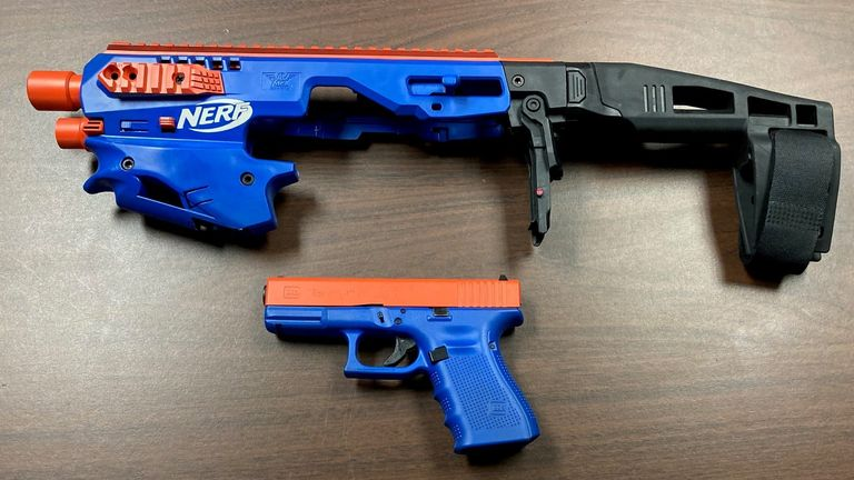 US police on a drugs raid at a house in North Carolina discovered a semi-automatic pistol disguised as a toy Nerf gun. Pic: Catawba County Sheriff's Office