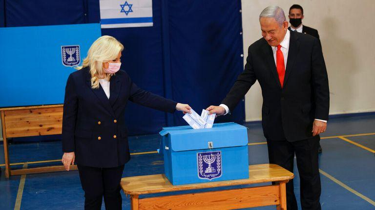 Mr Netanyahu and his wife Sara cast their ballots. Pic: AP