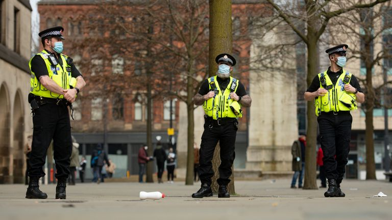 Police patrol St Peter's Square in Manchester after breaking up the protest