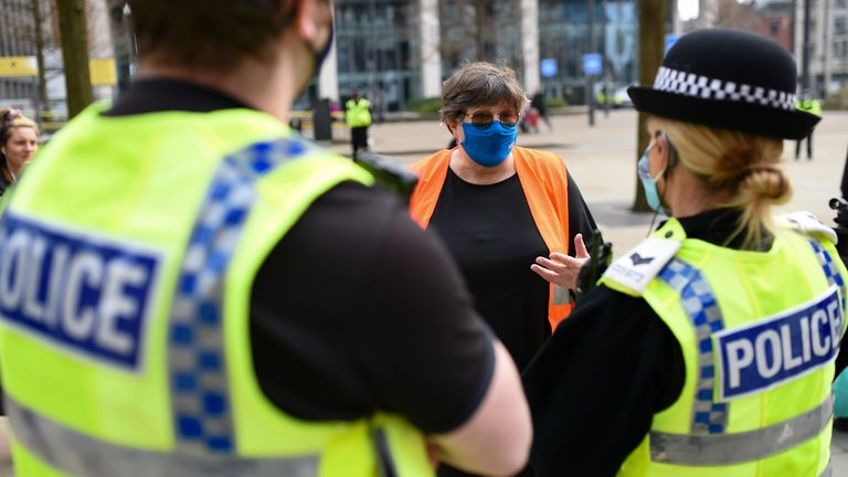 Police speak to NHS worker Karen Reissmann after breaking up a protest in Manchester