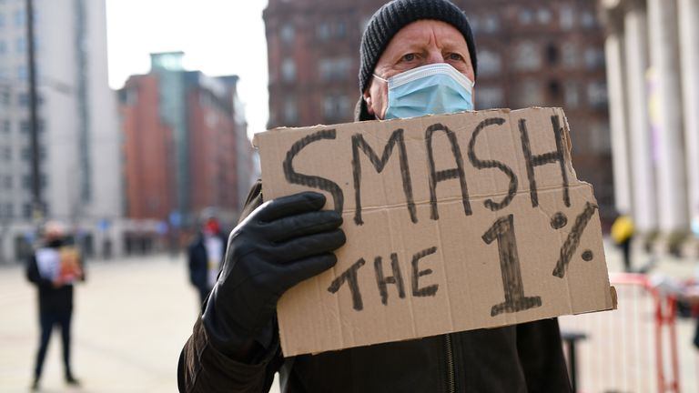 A man takes part in the protest over the proposed 1% pay rise for NHS workers