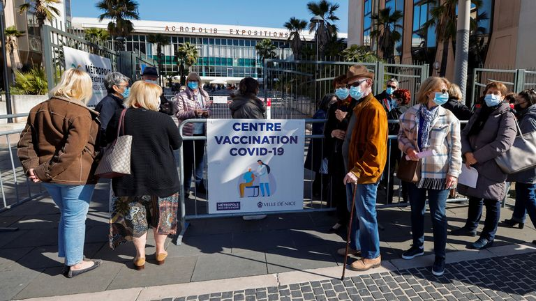 People wait to enter a vaccination center inside the exhibition palace as part of the coronavirus disease (COVID-19) vaccination campaign in Nice, France, March 13, 2021. REUTERS/Eric Gaillard