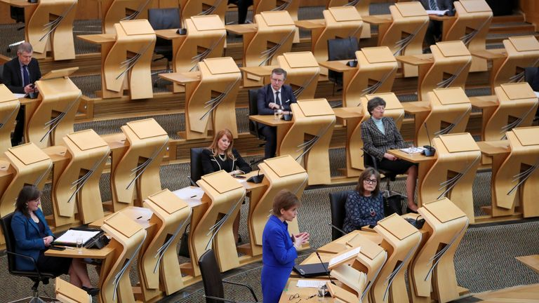 Scotland's First Minister Nicola Sturgeon makes a statement with an update about the coronavirus disease (COVID-19) pandemic, in Scottish parliament, Edinburgh, Scotland, Britain March 16, 2021. REUTERS/Russell Cheyne/Pool