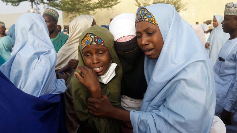 Parents are reunited with their daughter in Jangabe, Nigeria, Wednesday, March 3, 2021. More than 300 schoolgirls kidnapped last week in an attack on their school in northwest Nigeria have arrived in Jangabe after been freed on Tuesday. The Girls were abducted few days ago from Government Girls Secondary School in Jangabe in Zamfara state (AP Photo/Sunday Alamba)
