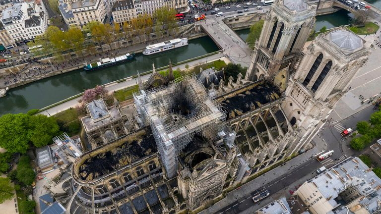 In this Tuesday April 16, 2019 file image made available by Gigarama.ru shows an aerial shot of the fire damage to Notre Dame cathedral in Paris. A French activist group has filed a lawsuit over health threats from toxic lead released in Notre Dame Cathedral's devastating fire. Hundreds of tons of lead melted when the April fire destroyed the cathedral's roof and spire, and exceptionally high lead levels were later recorded in the surrounding air. (Gigarama.ru via AP, File)