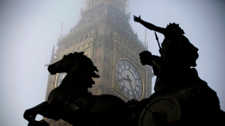 The Boudica statue stands in the foreground as fog shrouds the clock tower which houses the 'Big Ben' bell of the Palace of Westminster in London, Thursday, March 15, 2012. (AP Photo/Matt Dunham)