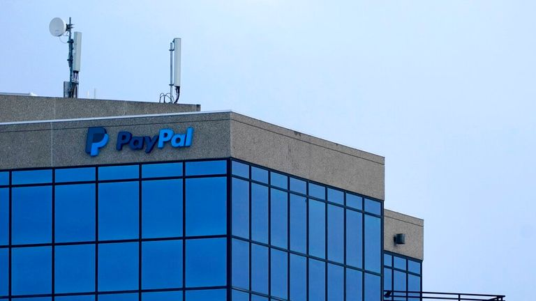 A sign for PayPal is seen on a building, Monday, Feb. 22, 2021, in Lutherville-Timonium, Md. (AP Photo/Julio Cortez)