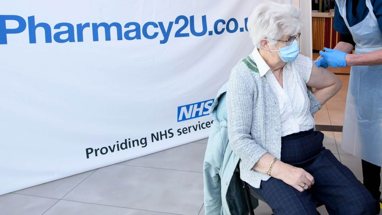EDITORIAL USE ONLY Christina Watkins, aged 82, from Aylesbury is one of the first people to receive the Oxford/AstraZeneca vaccine at the opening of the first Pharmacy2U Covid-19 vaccination centre at the Odeon Cinema in Aylesbury. 21/1/21