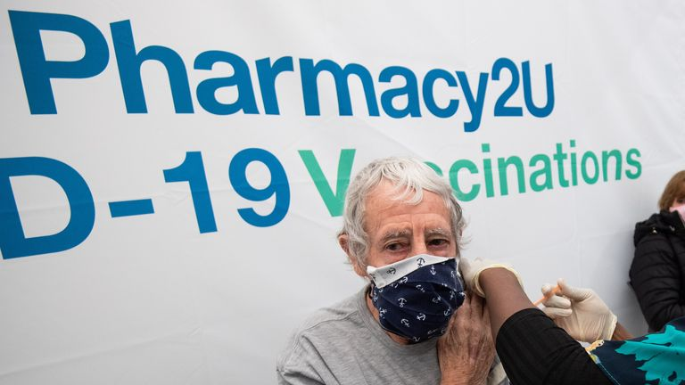 EDITORIAL USE ONLY Lesley Mitchell, aged 75, from Newmarket, receives the Oxford/Astrazeneca vaccine, watched by his wife Janice at the opening of a Pharmacy2U Covid-19 vaccination centre, at the Newmarket Racecourse, Suffolk. Picture date: Saturday January 30, 2021.