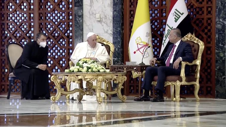 Iraqi Prime Minister Mustafa Al-Kadhimi welcomes Pope Francis as he arrives at Baghdad International Airport to start his historic tour in Baghdad, Iraq, March 5, 2021, in this screen grab taken from video. Iraqiya TV/Reuters TV via REUTERS ATTENTION EDITORS - THIS IMAGE HAS BEEN SUPPLIED BY A THIRD PARTY