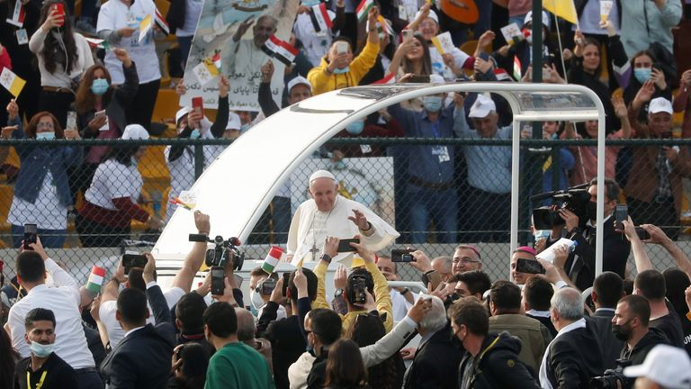 Pope Francis arrives to hold a mass at Franso Hariri Stadium in Erbil