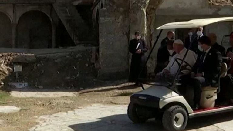 The Pope surveys the ruins of a church in Mosul