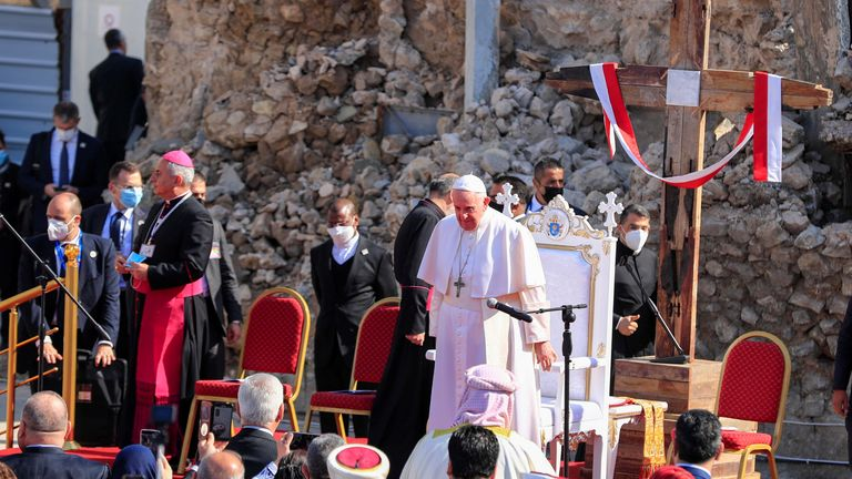 Pope Francis arrives to pray for war victims in Church Square in Mosul - a former Islamic State stronghold in Iraq