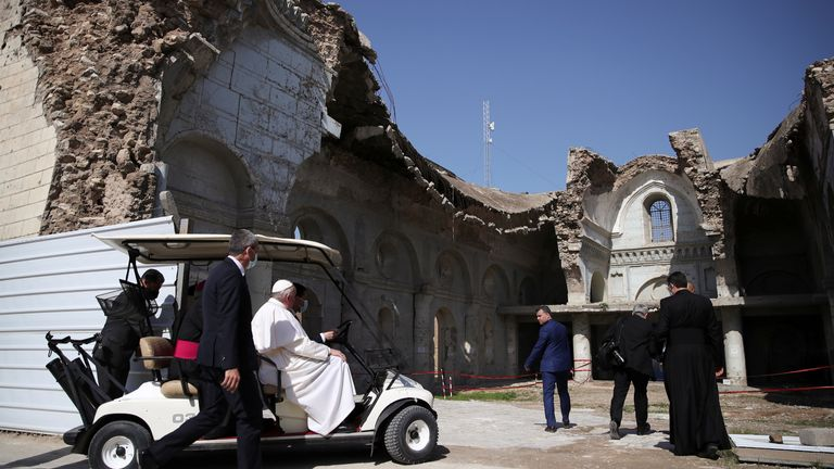 Pope Francis arrives to hold a minute of silence at the destroyed cathedral