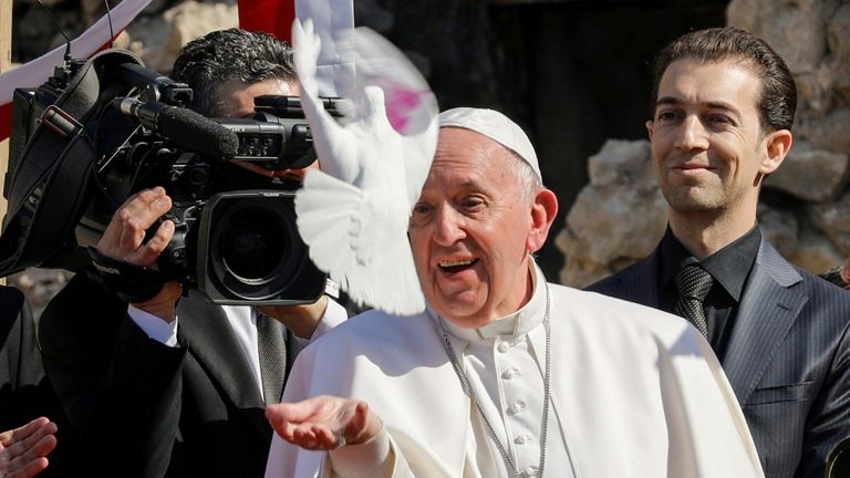 Pope Francis releases a white dove during a prayer for war victims